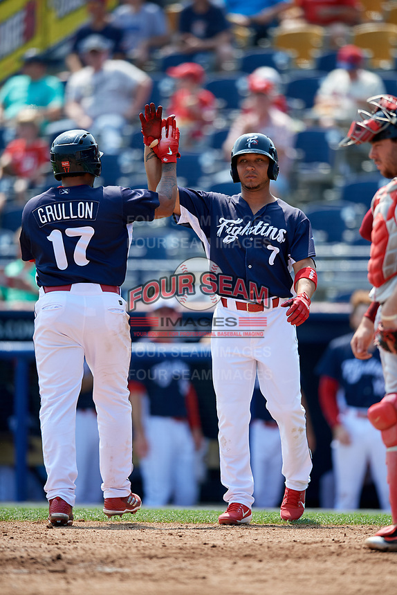 Reading Fightin Phils catcher Deivi Grullon (17) celebrates with Jiandido Tromp (7) after hitting a second inning home run during the first game of a doubleheader against the Portland Sea Dogs on May 15, 2018 at FirstEnergy Stadium in Reading, Pennsylvania.  Portland defeated Reading 8-4.  (Mike Janes/Four Seam Images)