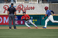 Springfield Cardinals second baseman Irving Lopez (11) flips the ball to second as Tony Sanchez (55) runs the bases during a Texas League game against the Frisco RoughRiders on May 5, 2019 at Dr Pepper Ballpark in Frisco, Texas.  (Mike Augustin/Four Seam Images)