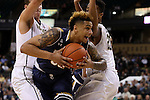 24 February 2016: Notre Dame's Zach Auguste (center) is defended by Wake Forest's Konstantinos Mitoglou (GRE) (left) and John Collins (20). The Wake Forest University Demon Deacons hosted the University of Notre Dame Fighting Irish at Lawrence Joel Veterans Memorial Coliseum in Winston-Salem, North Carolina in a 2015-16 NCAA Division I Men's Basketball game. Notre Dame won the game 69-58.