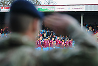 Scunthorpe United players are seen through the saluting arm of a representative of the military during an Act of Remembrance prior to the game<br /> <br /> Photographer Chris Vaughan/CameraSport<br /> <br /> The EFL Sky Bet League One - Scunthorpe United v Bristol Rovers - Saturday 11th November 2017 - Glanford Park - Scunthorpe<br /> <br /> World Copyright &copy; 2017 CameraSport. All rights reserved. 43 Linden Ave. Countesthorpe. Leicester. England. LE8 5PG - Tel: +44 (0) 116 277 4147 - admin@camerasport.com - www.camerasport.com
