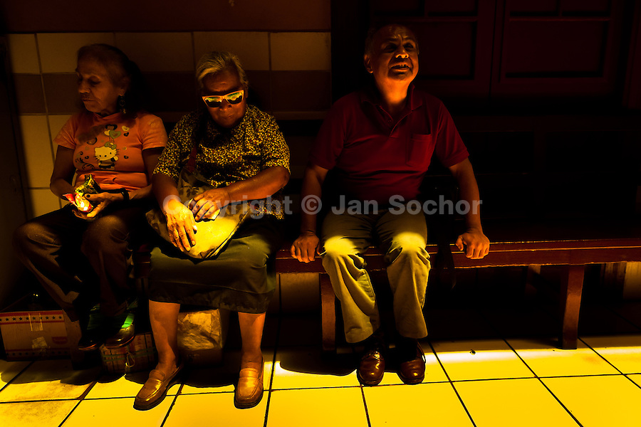 Blind people chat in the foyer of Unión Nacional de Ciegos del Perú, a social club for the visually impaired in Lima, Peru, 5 April 2013. Unión Nacional de Ciegos del Perú, one of the first societies for disabled in Latin America, was established in 1931 to provide a daily service for blind and partially sighted people from the capital city. The range of activities includes reading books in a large Braille library, playing chess or using a computer adapted for visually impaired individuals. As the majority of the blind does not have a regular job, the UNCP club offers them an opportunity to learn and lately, to provide massages to the club visitors and thus generate some income.