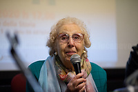 """Iole Mancini (Antifascist Partizan. Member of the Partigiani: the Italian Resistance during WWII). <br /> <br /> Rome, 19/02/20. Today, ANPI Roma (National Association of Italian Partizans, Members of the WWII Italian Resistance) celebrated the 100th birthday of Partizan Iole Mancini holding a fully booked public event at the Casa della Memoria e della Storia di Roma (House of Memory and History of Rome). From the ANPI event page: «Iole, belonging to the Roman Resistance, was arrested during the days immediately before the liberation of Rome. She was interrogated and tortured by the SS (by Kappler himself) in Via Tasso prison, in an attempt to extort the place where her boyfriend Ernesto Borghesi was hiding, gappista (*), but without success. Fleeing the arrival of the Allies, the Germans loaded all the prisoners detained in the prison onto three trucks, but the truck on which Iole had been placed did not leave due to a breakdown. All the other prisoners were killed in La Storta. Today it is still with us, with her splendid 100 years, and we celebrate it with pride and gratitude».<br /> (*) The GAPs - Gruppi di Azione Patriottica (Patriotic Action Groups, https://bit.ly/2K3jCmJ) were famous because their members, called """"Gappisti"""", carried out acts of sabotage & guerrilla warfare against nazi-fascist troops in cities such as Rome, Milan, Genova, Bologna and others.<br /> <br /> Footnotes & Links:<br /> 1. http://bit.do/fwe8Z<br /> http://www.anpiroma.org<br /> Le Grandi Novantenni, Iole Mancini torturata dalle Ss: """"Quello che accade oggi mi fa paura"""" (Source, laStampa.it, ITA) http://bit.do/fwfbz<br /> 25 Aprile at Ferramonti concentration camp http://bit.do/fwfgf<br /> Bella Ciao Tina Costa: Homage to a Partizan http://bit.do/fwffV<br /> Mario Fiorentini:100th Birthday of a Partizan http://bit.do/fwfeP<br /> forza nuova (far-right) Rally - ANPI & Antifascists Counter Protest https://bit.ly/2qC4ZuE<br /> Centocelle: Gold Medal For Antifascist Resistance https://bit."""