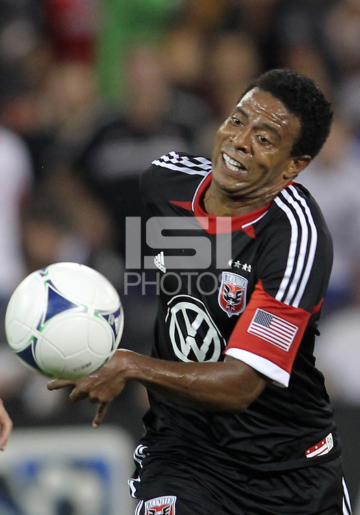 WASHINGTON, DC. - AUGUST 22, 2012:  Lionard Pajoy (26) of DC United races to a loose ball against the Chicago Fire during an MLS match at RFK Stadium, in Washington DC,  on August 22. United won 4-2.