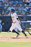 Asheville Tourists right fielder Jonathan Daza (2) swings at a pitch during a game against the Rome Braves on July 26, 2015 in Asheville, North Carolina. The Tourists defeated the Braves 16-4. (Tony Farlow/Four Seam Images)