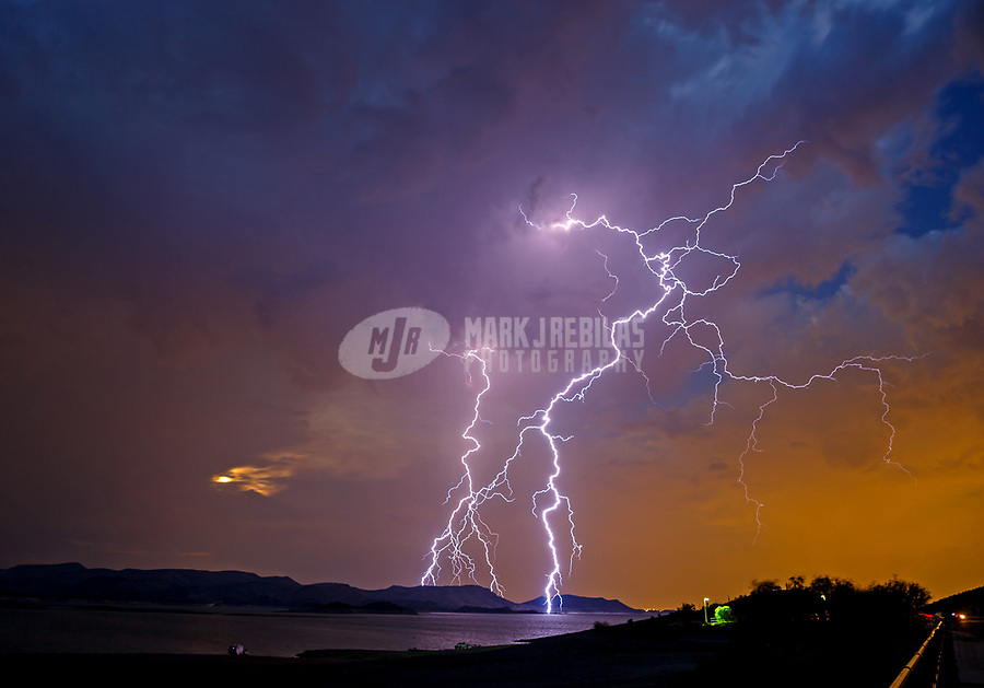 Sep 5, 2017; Lake Pleasant, Arizona, USA;   Lightning strikes over Lake Pleasant during a summer monsoon thunderstorm. Mandatory Credit: Mark J. Rebilas
