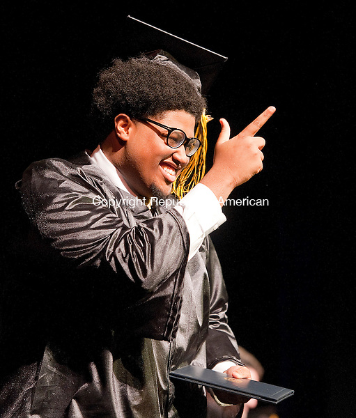 WATERBURY, CT-062014JS03--Kaynor Tech graduate Joquan Kinsey (Culinary Arts)  gestures to his classmates after receiving his diploma during graduation ceremonies Thursday at the Palace Theater in Waterbury. ]Jim Shannon Republican-American