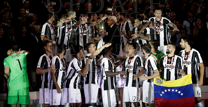 Football Soccer - Juventus - Lazio - Italian Cup Final - Olympic Stadium, Rome, Italy, May17,2017.<br /> Juventus team celebrate with the trophy after winning the Italian Cup Final match at Rome's Olympic stadium, on May 17, 2017.<br /> UPDATE IMAGES PRESS/Isabella Bonotto