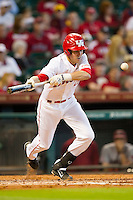 Chase Jensen #17 of the Houston Cougars lays down a bunt against the Arkansas Razorbacks at Minute Maid Park on March 3, 2012 in Houston, Texas.  The Cougars defeated the Razorbacks 4-1.  Brian Westerholt / Four Seam Images