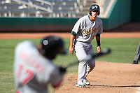 Phoenix Desert Dogs catcher Ryan Ortiz #16 leads off third base as Brodie Greene #9 bats during an Arizona Fall League game against the Mesa Solar Sox at HoHoKam Park on November 3, 2011 in Mesa, Arizona.  Mesa defeated Phoenix 8-7.  (Mike Janes/Four Seam Images)
