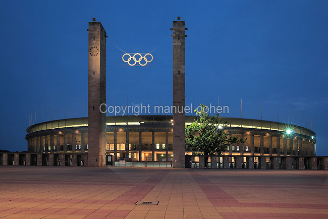 Entrance to the Olympiastadion, with 2 towers and the Olympic Rings symbol, built by Werner March for the 1936 Summer Olympics, Olympiapark Berlin, Berlin, Germany. The stadium itself was rebuilt and reinaugurated in 2004. Picture by Manuel Cohen