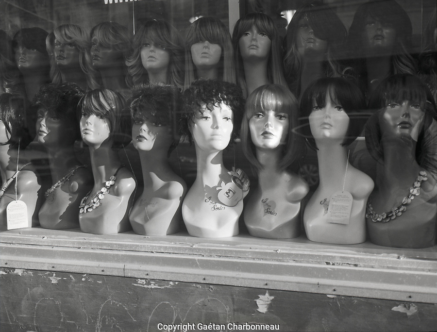 A window with wigs display