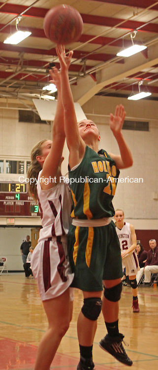 Torrington, CT-122313MK01 Holy Cross' Melissa Grocki puts up a shot in front of Torrington's Brittany Anderson during NVL basketball action at Torrington High School Monday night.  Holy Cross defeated Torrington 52-43.  Michael Kabelka Republican-American