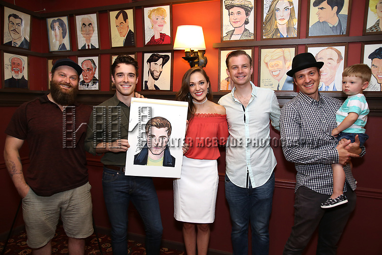 Corey Cott and Laura Osnes with band cast members during the Corey Cott Sardi's Portrait unveiling at Sardi's Restaurant on August 11, 2017 in New York City.
