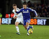 Swansea, UK Saturday 17 January 2015<br /> L-R Tom Carroll of Swansea chasing Eden Hazard of Chelsea<br /> Barclays Premier League, Swansea City FC v Chelsea at the Liberty Stadium, south Wales, UK