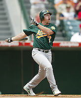 Jeremy Giambi of the Oakland Athletics bats during a 2002 MLB season game against the Los Angeles Angels at Angel Stadium, in Anaheim, California. (Larry Goren/Four Seam Images)