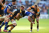Jackson Willison of Bath Rugby is double-tackled by Thomas Young and Brad Shields of Wasps. Heineken Champions Cup match, between Wasps and Bath Rugby on October 20, 2018 at the Ricoh Arena in Coventry, England. Photo by: Patrick Khachfe / Onside Images