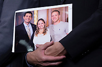 Speaker of the House of Representatives Paul Ryan, Republican of Wisconsin, holds a photo of an opioid survivior during a post Republican Caucus meeting press conference on Capitol Hill in Washington, DC on June 13, 2018. Credit: Alex Edelman / CNP /MediaPunch