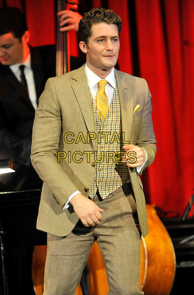 Matthew Morrison<br /> performing live in concert  a gig at Bush Hall, London, England, UK,  June 20th 2013.<br /> music live on stage gig half length beige suit yellow tie plaid checked waistcoat <br /> CAP/ROS<br /> &copy;Steve Ross/Capital Pictures