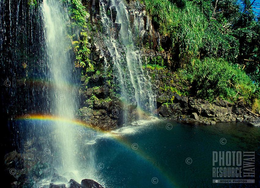 Waterfall in Hana, Maui with a rainbow.