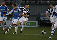 Chris Millar (left) and Jim Goodwin challenge in the St Mirren v St Johnstone Clydesdale Bank Scottish Premier League match played at St Mirren Park, Paisley on 8.12.12.