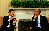 United States President Barack Obama, right, listens as President Enrique Peña Nieto of Mexico, left, makes remarks to the media in the Oval Office of the White House in Washington, D.C. on Tuesday, January 6, 2015.<br /> Credit: Dennis Brack / Pool via CNP