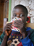 A boy plays cards in Mizak, a small village in the south of Haiti.