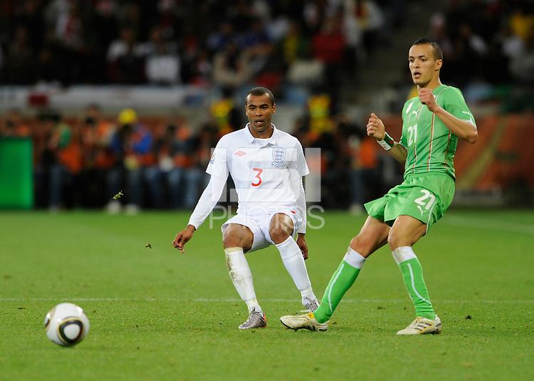 Ashley Cole of England and Foued Kadir of Algeria