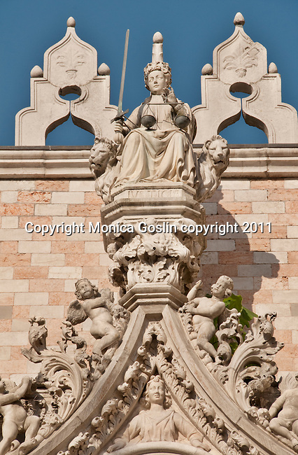 Sculptures on the Doge's Palace facade in Venice, Italy