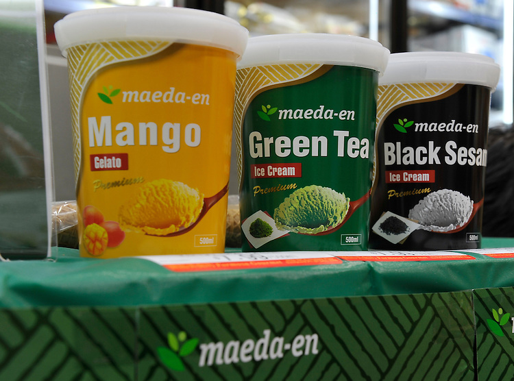 Containers are pictured during the launch of Maeda-en's range of green tea (C) and black sesame (R) ice cream and mango sorbet (L) at Formosa Asian Market, Sunnybank, , Brisbane, Queensland, Saturday, October 01, 2011. (Photo by John Pryke/JKDImagery)