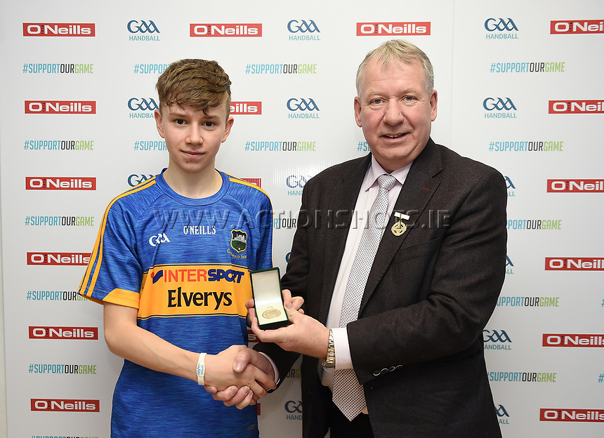 19/03/2018; 40x20 All Ireland Juvenile Championships Finals 2018; Kingscourt, Co Cavan;<br /> Boys Under-15 Singles; Kilkenny (John Doheny) v Tipperary (Rory Grace)<br /> Rory Grace accepts his winners medal from GAA Handball President Joe Masterson<br /> Photo Credit: actionshots.ie/Tommy Grealy