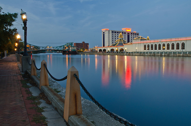 Harrah's Casino sits on the bank of and the Cass Street Bridge crosses the DesPlaines River at dusk in Joliet, Illinois
