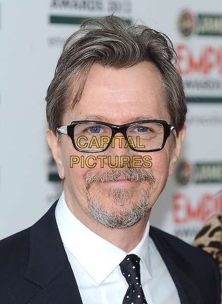 Gary Oldman.Jameson Empire Film Awards at the Grosvenor House Hotel, Park Lane, London, England..March 25th 2012.headshot portrait black white goatee glasses facial hair.CAP/BF.©Bob Fidgeon/Capital Pictures.