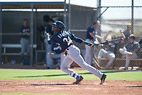 Milwaukee Brewers right fielder Larry Ernesto (24) follows through on his swing during an Instructional League game against the San Diego Padres at Peoria Sports Complex on September 21, 2018 in Peoria, Arizona. (Zachary Lucy/Four Seam Images)