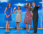 United States President Barack Obama and his family on the podium following his acceptance speech at the 2012 Democratic National Convention in Charlotte, North Carolina on Thursday, September 6, 2012.  From left to right: Malia Obama, Sasha Obama, first lady Michelle Obama, and President Obama.  .Credit: Ron Sachs / CNP.(RESTRICTION: NO New York or New Jersey Newspapers or newspapers within a 75 mile radius of New York City)