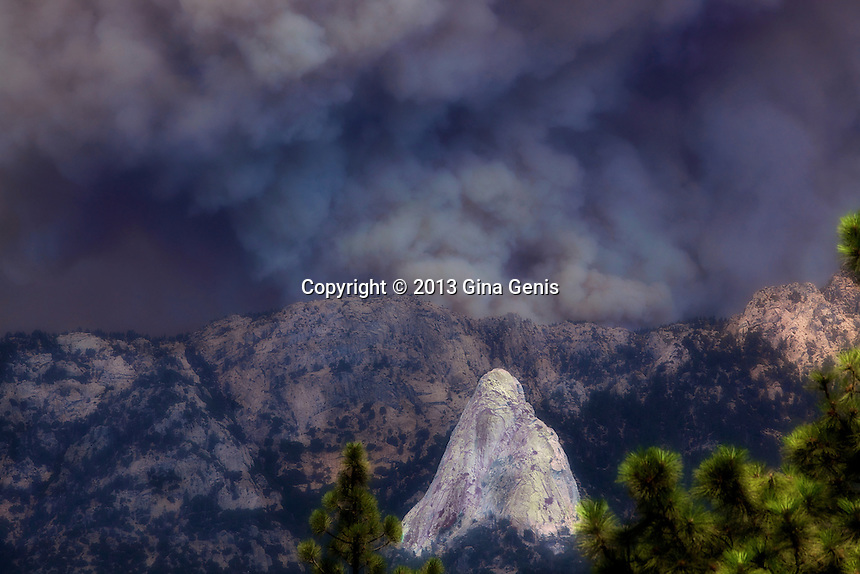 A close up of Tahquitz Rock as it is threatened by a massive fire plume. July 17, 2013.