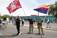"Phoenix, Arizona – Neo-Nazi and border vigilante Jason ""J.T."" Ready (center) waves a Gadsden Flag during an immigrant protest in Phoenix, Arizona on May 2, 2009. To his right is Thomas Colletto (AKA Vito Lombardi) stepping on a Mexican flag. Coletto would later leave Ready's vigilante group. The man to his left is unidentified. Ready would kill four members of a family three years later on the very same date –May 2, 2012– before taking his own life. The victims were Lisa Mederos, Amber Mederos, baby Lilly Mederos, and Amber's fiancé Jim Hiott. The massacre occurred in the town of Gilbert, Arizona, about 25 miles southeast of Phoenix. Ready was Lisa's boyfriend and according to police, a domestic violence incident may have caused the killings. Photo by Eduardo Barraza © 2009"