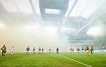 Solna 2014-08-13 Fotboll Allsvenskan AIK - Djurg&aring;rdens IF :  <br /> Djurg&aring;rdens och AIK:s spelare g&aring;r av planen innan avspark pga r&ouml;k fr&aring;n bengaliska eldar <br /> (Foto: Kenta J&ouml;nsson) Nyckelord:  AIK Gnaget Friends Arena Allsvenskan Derby Djurg&aring;rden DIF supporter fans publik supporters