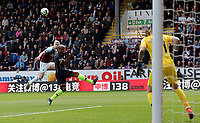 Burnley's Ben Mee lifts a close range shot over the Manchester City goal under pressure from Vincent Kompany<br /> <br /> Photographer Rich Linley/CameraSport<br /> <br /> The Premier League - Burnley v Manchester City - Sunday 28th April 2019 - Turf Moor - Burnley<br /> <br /> World Copyright © 2019 CameraSport. All rights reserved. 43 Linden Ave. Countesthorpe. Leicester. England. LE8 5PG - Tel: +44 (0) 116 277 4147 - admin@camerasport.com - www.camerasport.com
