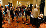 Players line up to pay for food during a break between levels.