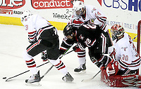 Nebraska-Omaha's Bryce Aneloski (No. 24) and Andrej Sustr (No. 3) work to keep the puck away from St. Cloud State's David Eddy during Friday's game. UNO beat St. Cloud State 3-0 Friday night at Qwest Center Omaha. (Photo by Michelle Bishop).