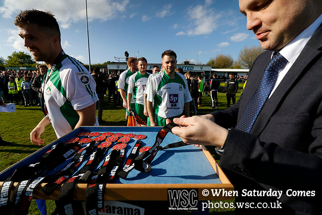 North Ferriby players line up to receive winners medals. Vanarama National League North, Promotion Final, North Ferriby United v AFC Fylde, 14th May 2016.