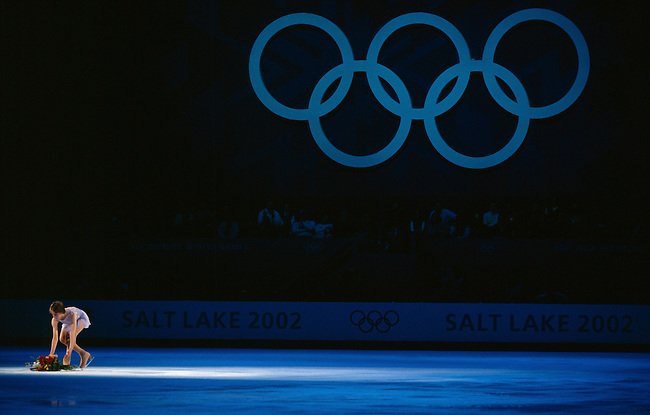 Gold-medalist Sara Hughes places a bouquet of flowers at center ice in memory of Sept. 11 before her final skate in the figure skating exhibition at the Winter Olympics in Salt Lake City on Feb. 22, 2002.