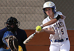 Western Nevada College's Meghan Hospodka hits a solo home run during a college softball game against Salt Lake Community College at Edmonds Sports Complex in Carson City, Nev., on Fri., Feb. 14, 2014. WNC, who lost 5-14 and 5-7, will play a doubleheader Saturday beginning at noon. <br /> Photo by Cathleen Allison/Nevada Photo Source