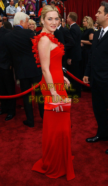 KATE WINSLET.74th Academy Awards .oscars, red ben de lisi dress, clutch purse, red carpet, sleeveless, full length, full-length.www.capitalpictures.com.sales@capitalpictures.com.© Capital Pictures