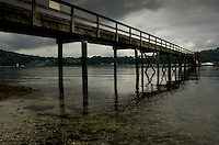 Wooden walkway to jetty. Deep Cove area, North Vancouver, British Columbia, Canada.