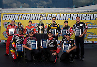 Sep 13, 2013; Charlotte, NC, USA; NHRA top fuel dragster driver (front row from left) Antron Brown , Shawn Langdon , Spencer Massey , Tony Schumacher (back row from left) Doug Kalitta , Khalid Albalooshi , Clay Millican , Morgan Lucas , Steve Torrence and Bob Vandergriff Jr pose for a photo as the drivers who will battle for the championship prior to qualifying for the Carolina Nationals at zMax Dragway. Mandatory Credit: Mark J. Rebilas-