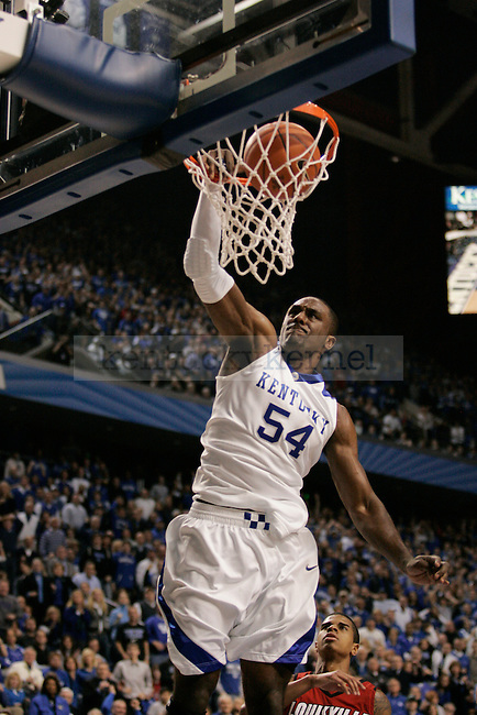 Senior forward Patrick Patterson makes a dunk in the first half of UK's 71-62 win over Louisville at Rupp Arena on Saturday, Jan. 2, 2010. Photo by Britney McIntosh | Staff