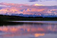 Sunset on North America's highest mountain, reflecting in Wonder Lake, summer, Denali National Park, Alaska