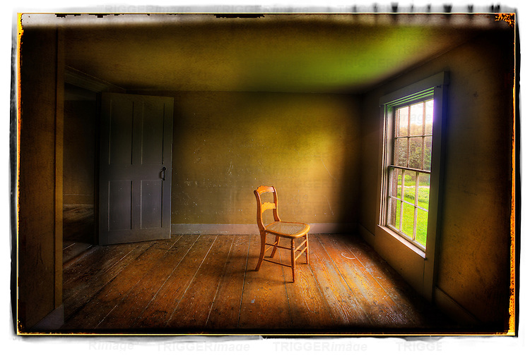 Old Chair In Empty Room With Window