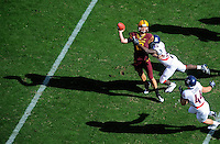 Nov. 28, 2009; Tempe, AZ, USA; Arizona State Sun Devils quarterback (10) Samson Szakacsy throws a pass under pressure from Arizona Wildcats linebacker (15) Xavier Kelley in the first quarter at Sun Devil Stadium. Mandatory Credit: Mark J. Rebilas-